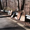 11/16/2015, Jon Merryman,  Balto. County Thistle Branch  stream (a small stream that runs parallel to Thistle Road in Catonsville) found these pieces of wood.  Picture 2 of 2,  All this junk was tossed over the guardrail down the hill toward Thistle Run in Catonsville/Oella. Estimated weight is 100 pounds.