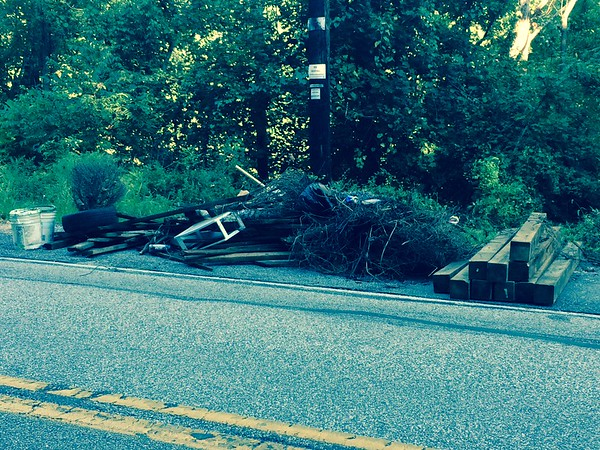 9/23/2015, Jon Merryman, Patapsco River Watershed, Nursery Road AA County, Two piles of junk here from two dumping events. This one has 10 4x4's approximately 5 feet long, wire, one tire, 3 contractor buckets, 7 pieces of wood and other trash.  Thought I reported the first one but it's been here a while so thinking I might've forgotten to report it.  Estimated weight  125 pounds.