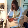 Beautiful baker making cinnamon rolls:pumpkin bread for aprreciate eater!
