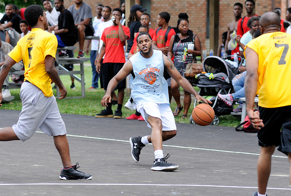 Don Knight | The Herald Bulletin<br /> Anderson High School boys basketball coach  Phil Washington participates in the Zaki Ali Dust Bowl Basketball Classic during the Anderson Black Expo on Saturday.