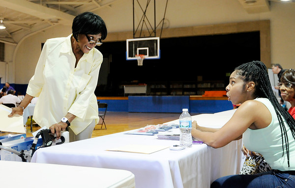 Don Knight | The Herald Bulletin<br /> Lynnett Nelson, left, talks to Sherry Coleman at the Martin Center booth during the health fair at the Anderson Black Expo on Saturday.