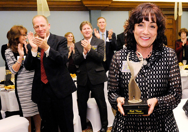 Don Knight   The Herald Bulletin<br /> Beth Tharp, CEO and president of Community Hospital Anderson, holds her Athena at the Anderson Country Club on Thursday.