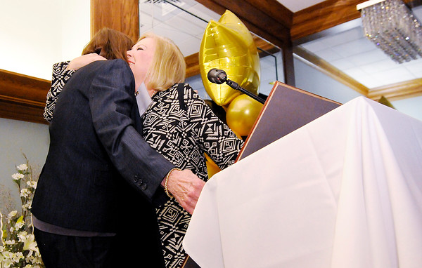 Don Knight | The Herald Bulletin<br /> State representative Terri Austin hugs Lynn Staley as she presents her with a Sagamore of the Wabash during the Athena and Shining Star awards dinner at the Anderson Country Club on Thursday. Staley was last year's Athena winner but was unable to attend the dinner after being injured in a fall.