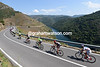 The peloton swoops down to the Sacra river that sits amidst the regions famous vineyards...