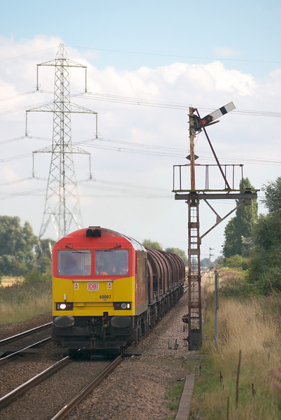 The Rotherham Tripper Loco still sometimes is a class 60 most of the time the diagram is worked by a 66. <br /> <br /> Hear 60007 is seen getting back into its stride whislt working 6J94 1225 Hull Steel Terminal - Rotherham Masborough with 12 Loaded BYA covered steel coil carriers in tow.