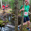 BANGOR, Maine -- 04/29/2017 -  Jessica Bloom-Foster (right) successfully navigates a section of water during the annual Epic Sports' Rabbit Run race through the Bangor City Forest in Bangor Saturday. The 5.25 mile course saw over 100 runners. Proceeds went to benefit the Bangor Humane Society and the Clifton Climbers Association. Ashley L. Conti | BDN