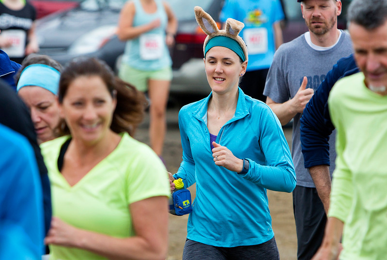 BANGOR, Maine -- 04/29/2017 -  Runners make their way past the start during the annual Epic Sports' Rabbit Run race through the Bangor City Forest in Bangor Saturday. The 5.25 mile course saw over 100 runners. Proceeds went to benefit the Bangor Humane Society and the Clifton Climbers Association. Ashley L. Conti | BDN