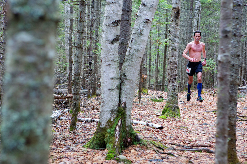 BANGOR, Maine -- 04/29/2017 - Ivan Schwendt navigates a trail during the annual Epic Sports' Rabbit Run race through the Bangor City Forest in Bangor Saturday. The 5.25 mile course saw over 100 runners. Proceeds went to benefit the Bangor Humane Society and the Clifton Climbers Association. Ashley L. Conti | BDN