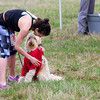 BANGOR, Maine -- 04/29/2017 -  Danielle Cowette puts a t-shirt on her dog Blaze before the start of the annual Epic Sports' Rabbit Run race through the Bangor City Forest in Bangor Saturday. The 5.25 mile course saw over 100 runners. Proceeds went to benefit the Bangor Humane Society and the Clifton Climbers Association. Ashley L. Conti | BDN