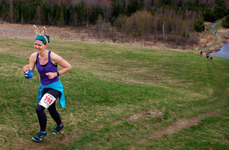 BANGOR, Maine -- 04/29/2017 -  A runner wearing rabbit ears make her way up the final hill during the annual Epic Sports' Rabbit Run race through the Bangor City Forest in Bangor Saturday. The 5.25 mile course saw over 100 runners. Proceeds went to benefit the Bangor Humane Society and the Clifton Climbers Association. Ashley L. Conti | BDN