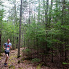 BANGOR, Maine -- 04/29/2017 - Andrew Phifer makes his way through the woods during the annual Epic Sports' Rabbit Run race through the Bangor City Forest in Bangor Saturday. The 5.25 mile course saw over 100 runners. Proceeds went to benefit the Bangor Humane Society and the Clifton Climbers Association. Ashley L. Conti | BDN