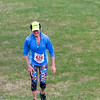 BANGOR, Maine -- 04/29/2017 - Joann Clough makes her way up the final hill during the annual Epic Sports' Rabbit Run race through the Bangor City Forest in Bangor Saturday. The 5.25 mile course saw over 100 runners. Proceeds went to benefit the Bangor Humane Society and the Clifton Climbers Association. Ashley L. Conti | BDN