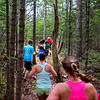 BANGOR, Maine -- 04/29/2017 -  Runners follow the trail during the annual Epic Sports' Rabbit Run race through the Bangor City Forest in Bangor Saturday. The 5.25 mile course saw over 100 runners. Proceeds went to benefit the Bangor Humane Society and the Clifton Climbers Association. Ashley L. Conti | BDN