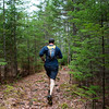 BANGOR, Maine -- 04/29/2017 - A runner follows the path during the annual Epic Sports' Rabbit Run race through the Bangor City Forest in Bangor Saturday. The 5.25 mile course saw over 100 runners. Proceeds went to benefit the Bangor Humane Society and the Clifton Climbers Association. Ashley L. Conti | BDN