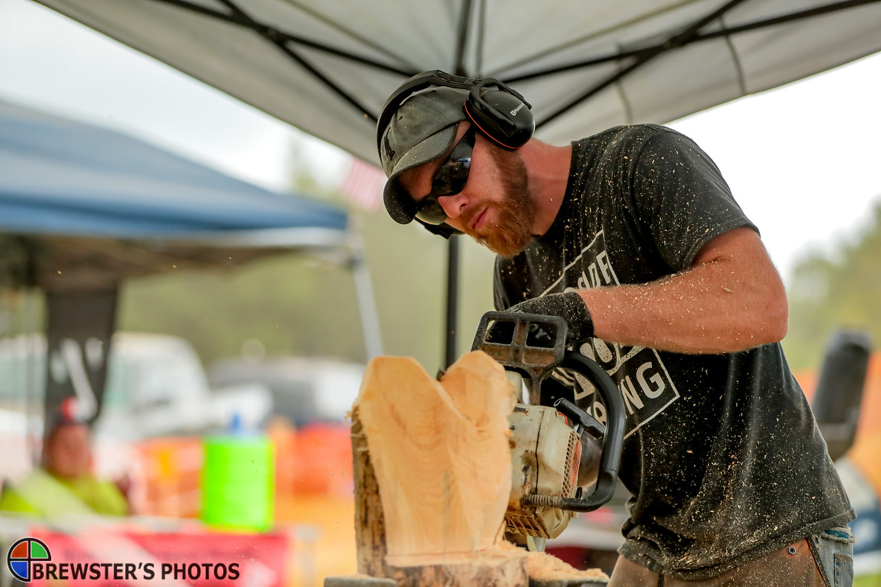 Greg Waters of Lisbon Falls works on a chainsaw wood carving.