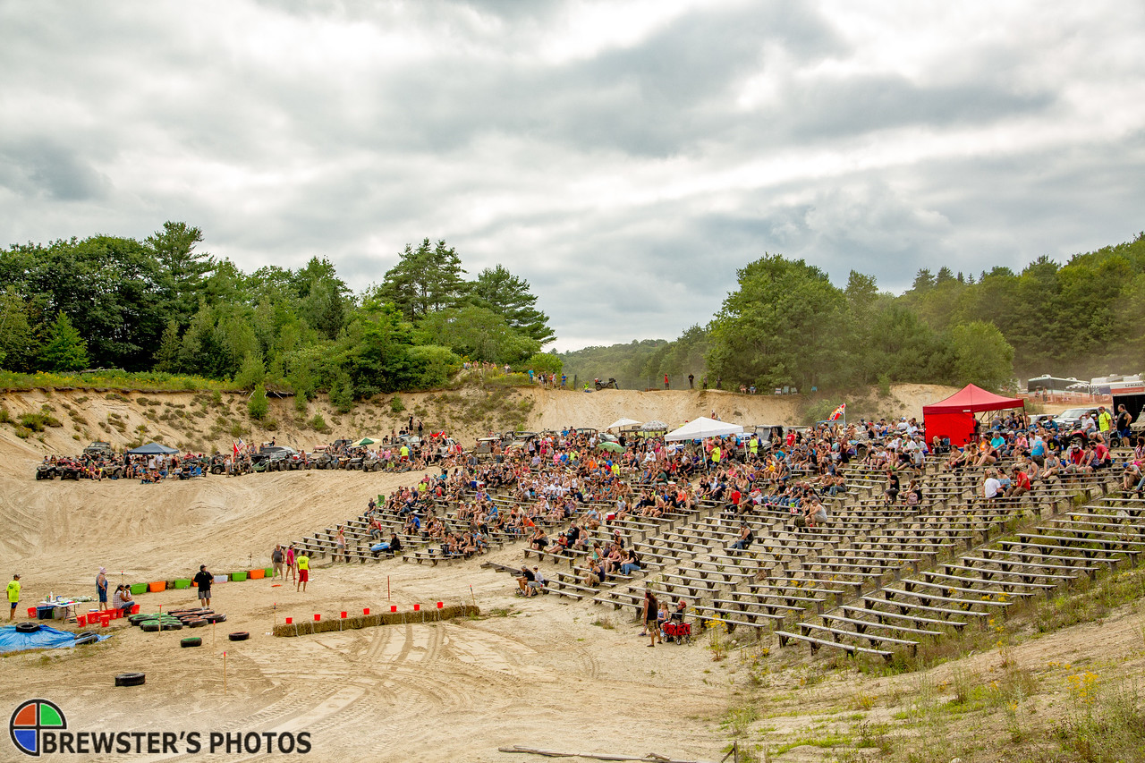 Fans watch the events in a gravel pit amphitheater.