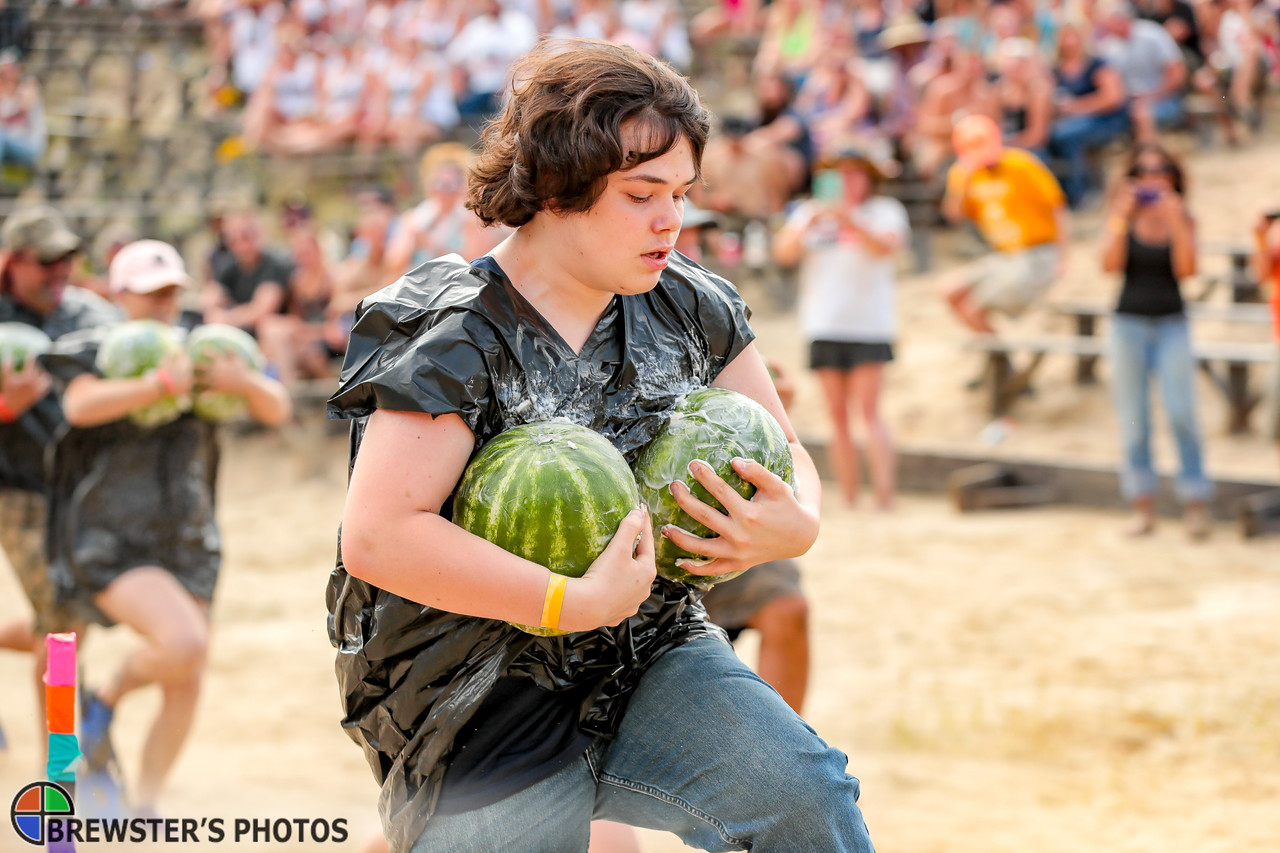 Laine Wellington of Warren gets off to a fast start in the Greased Melon Carry event yesterday at the Redneck Olympics in Minot.