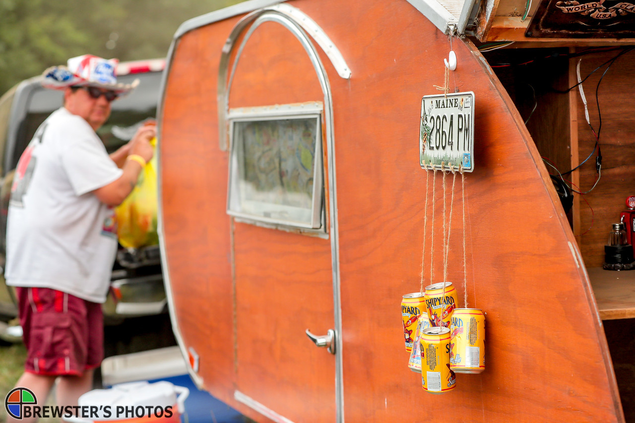"John Neff of Lisbon Falls displays what he calls redneck wind chimes on the side of his camper.  In the background, Neff gets ready to prepare a late lunch of Kielbasa. When asked whether Shipyard Summer Ale fit with the redneck theme, Neff explained, ""They were on sale."""