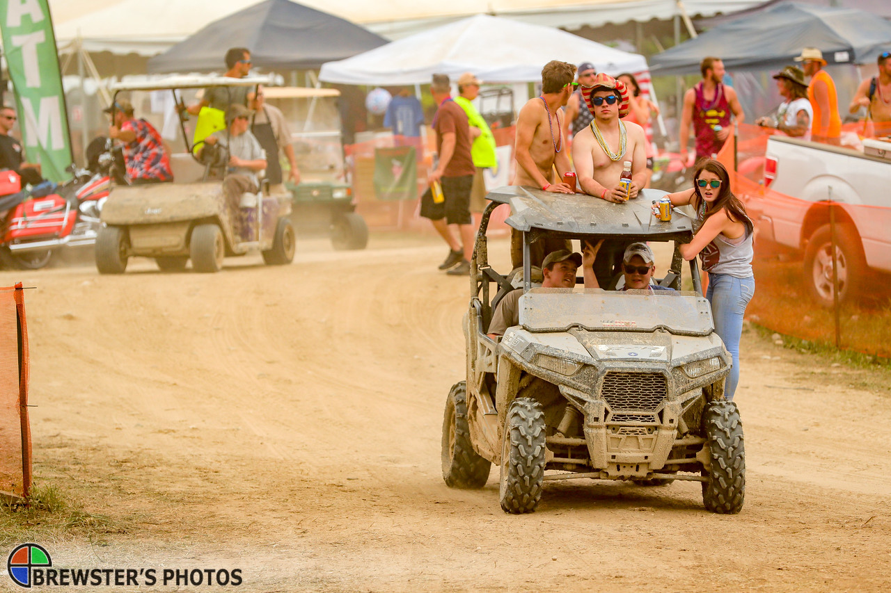 Most atendees traversed the grounds on sometimes overcrowded ATVs. Nearly all carried a drink.