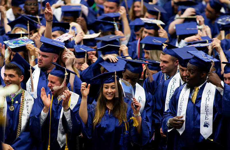 ORONO, Maine -- 05/13/2017 - Graduates celebrate after switching their tassels over during the University of Maine's 215th Commencement at Alfond Arena in Orono Saturday. More than 1,900 students, including 34 doctoral degree candidates, were expected to participate in the two commencement ceremonies. Ashley L. Conti | BDN
