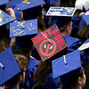 ORONO, Maine -- 05/13/2017 - A graduate's decorated cap jokes at their debt during the University of Maine's 215th Commencement at Alfond Arena in Orono Saturday. More than 1,900 students, including 34 doctoral degree candidates, were expected to participate in the two commencement ceremonies. Ashley L. Conti | BDN