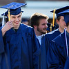 ORONO, Maine -- 05/13/2017 - A graduate fixes his tassel during the University of Maine's 215th Commencement at Alfond Arena in Orono Saturday. More than 1,900 students, including 34 doctoral degree candidates, were expected to participate in the two commencement ceremonies. Ashley L. Conti | BDN