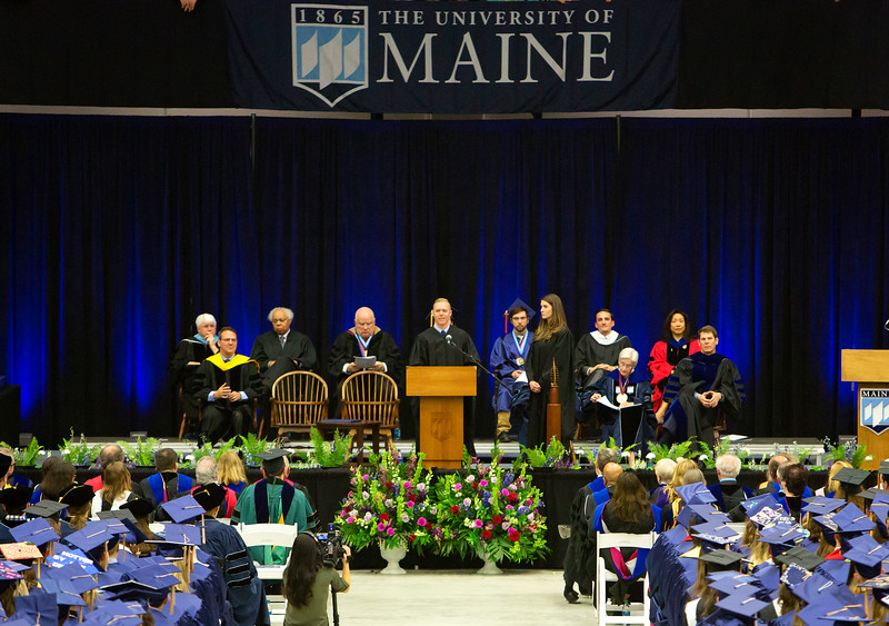 ORONO, Maine -- 05/13/2017 - Abe (center) and Heather Furth give the commencement address during the University of Maine's 215th Commencement at Alfond Arena in Orono Saturday. More than 1,900 students, including 34 doctoral degree candidates, were expected to participate in the two commencement ceremonies. Ashley L. Conti | BDN