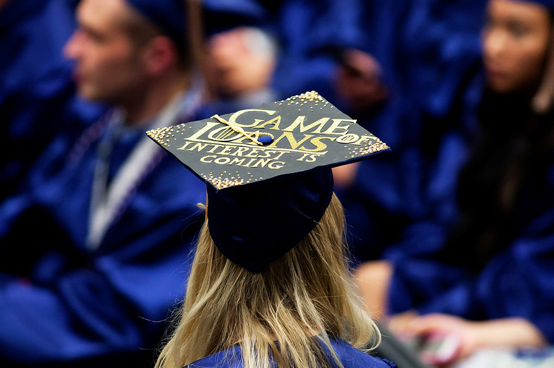 ORONO, Maine -- 05/13/2017 - A graduate's cap making fun of student debt is seen during the University of Maine's 215th Commencement at Alfond Arena in Orono Saturday. More than 1,900 students, including 34 doctoral degree candidates, were expected to participate in the two commencement ceremonies. Ashley L. Conti | BDN