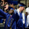 ORONO, Maine -- 05/13/2017 - A graduate motions to the crowd before getting his diploma during the University of Maine's 215th Commencement at Alfond Arena in Orono Saturday. More than 1,900 students, including 34 doctoral degree candidates, were expected to participate in the two commencement ceremonies. Ashley L. Conti | BDN
