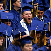ORONO, Maine -- 05/13/2017 - A graduate yawns during the University of Maine's 215th Commencement at Alfond Arena in Orono Saturday. More than 1,900 students, including 34 doctoral degree candidates, were expected to participate in the two commencement ceremonies. Ashley L. Conti | BDN