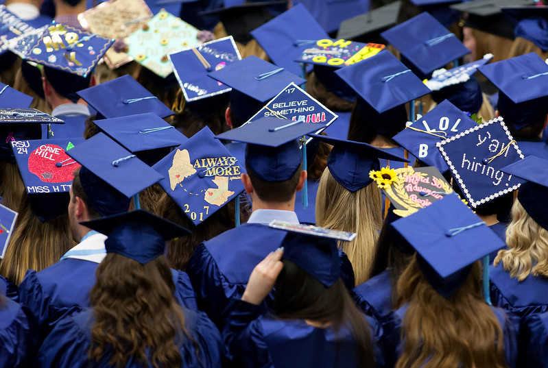ORONO, Maine -- 05/13/2017 - Graduates with decorated caps listen to speakers during the University of Maine's 215th Commencement at Alfond Arena in Orono Saturday. More than 1,900 students, including 34 doctoral degree candidates, were expected to participate in the two commencement ceremonies. Ashley L. Conti | BDN