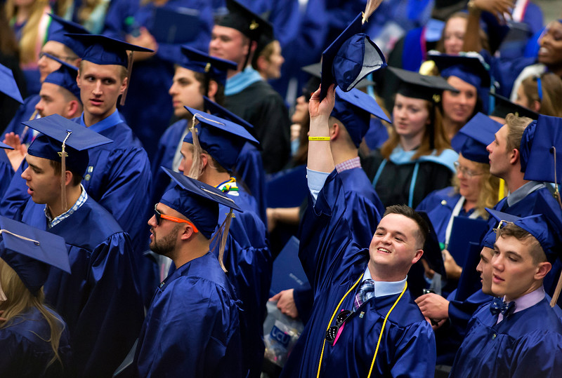ORONO, Maine -- 05/13/2017 - A graduate holds up his hat after receiving his diploma during the University of Maine's 215th Commencement at Alfond Arena in Orono Saturday. More than 1,900 students, including 34 doctoral degree candidates, were expected to participate in the two commencement ceremonies. Ashley L. Conti | BDN
