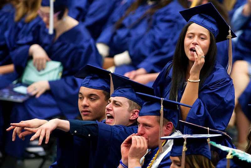 ORONO, Maine -- 05/13/2017 - Graduates cheer on their fellow classmates during the University of Maine's 215th Commencement at Alfond Arena in Orono Saturday. More than 1,900 students, including 34 doctoral degree candidates, were expected to participate in the two commencement ceremonies. Ashley L. Conti | BDN