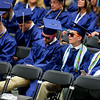 ORONO, Maine -- 05/13/2017 - Graduates relax after receiving their diplomas during the University of Maine's 215th Commencement at Alfond Arena in Orono Saturday. More than 1,900 students, including 34 doctoral degree candidates, were expected to participate in the two commencement ceremonies. Ashley L. Conti | BDN