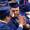 ORONO, Maine -- 05/13/2017 - Graduates high five each other before receiving their diplomas during the University of Maine's 215th Commencement at Alfond Arena in Orono Saturday. More than 1,900 students, including 34 doctoral degree candidates, were expected to participate in the two commencement ceremonies. Ashley L. Conti | BDN