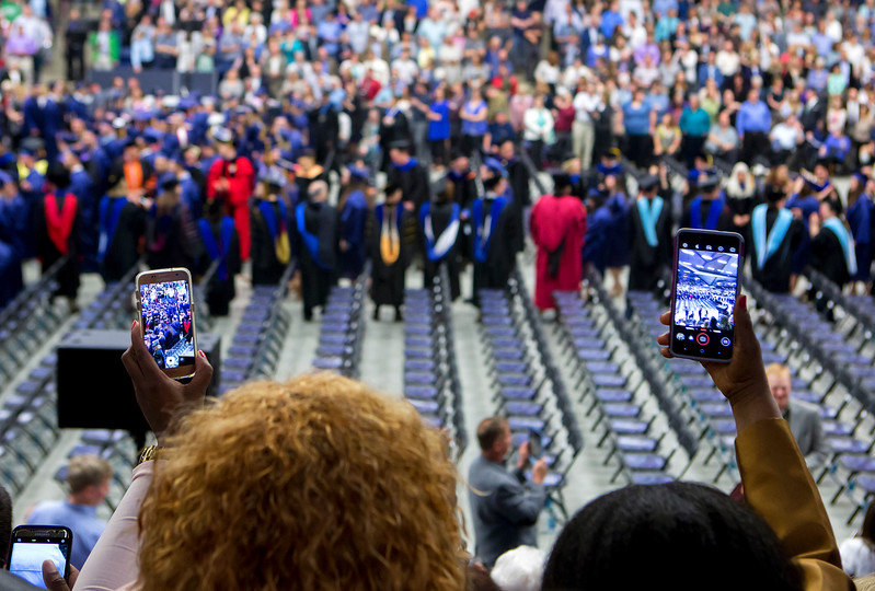 ORONO, Maine -- 05/13/2017 - People use their phones to record graduates entering Alfond Arena during the University of Maine's 215th Commencement in Orono Saturday. More than 1,900 students, including 34 doctoral degree candidates, were expected to participate in the two commencement ceremonies. Ashley L. Conti | BDN