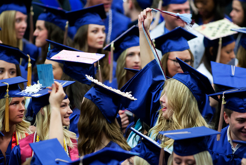 ORONO, Maine -- 05/13/2017 - A graduate swings her cords around during the University of Maine's 215th Commencement at Alfond Arena in Orono Saturday. More than 1,900 students, including 34 doctoral degree candidates, were expected to participate in the two commencement ceremonies. Ashley L. Conti | BDN