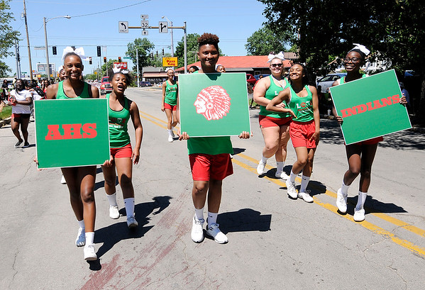 Don Knight | The Herald Bulletin<br /> The Anderson High School Cheerleaders march in the Black Expo parade on Saturday.