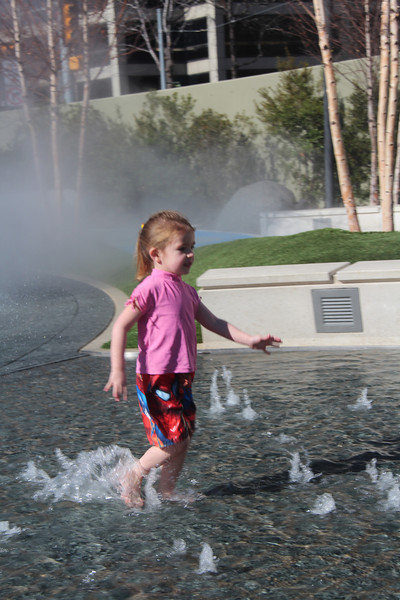 This little girl took off her shoes and ran through the shallow pool with fountains.  It was in the low 60s on this day, February 24, 2013.