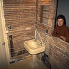 Remodeling the bathroom 1974. Marian is standing in what was then an enclosed back porch.