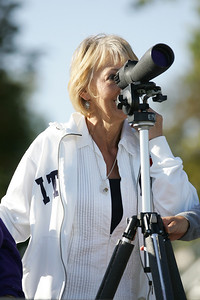 Jennie McClendon looks at the Canadian geese and sea gulls on the break walls through a telescope provided by Erie MetroParks. photo by Ray Riedel