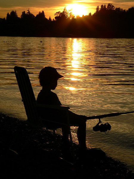 Last light of summer at Derbyreach Park in Surrey, BC.<br /> <br /> My 5 year old son after a long day and his first time fishing.  <br /> Not giving up, waiting for the big one.