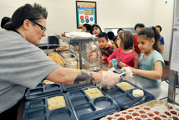 John P. Cleary   The Herald Bulletin<br /> Anderson Elementary School students go through the food line in the cafeteria  on this Wednesday choosing from chicken & noodles, or hotdogs.
