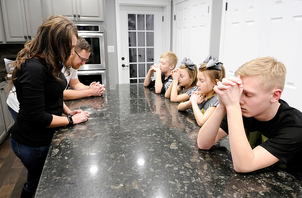 Don Knight | The Herald Bulletin<br /> Chris and Shannon Wedekind and their children Gaven, 14, Ethan, 12, and the twins, Dylan and Devyn, 8, pray before eating dinner.