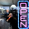 John P. Cleary | The Herald Bulletin<br /> The OPEN sign glows in the window of the oldest continuously active barber shop in Madison County.