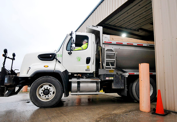 John P. Cleary | The Herald Bulletin<br /> The first truck roll out of the Madison County Highway garage a little before 8 a.m. on this Wednesday to take care of a downed tree on a county road that needs attention.