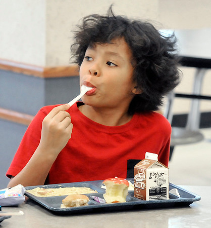 John P. Cleary | The Herald Bulletin<br /> Anderson Elementary School second-grader Dyson Simpson, 9, is enjoying his chicken & noodles this day.