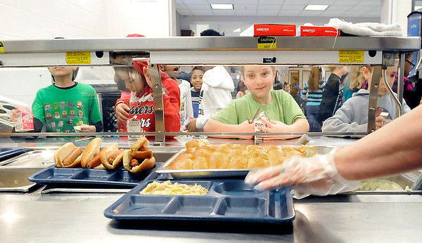 John P. Cleary | The Herald Bulletin<br /> Anderson Elementary School students go through the food line in the cafeteria  on this Wednesday choosing from chicken & noodles, or hotdogs.