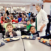John P. Cleary | The Herald Bulletin<br /> Anderson Elementary School cafeteria volunteer Naomi McClintick, 84, goes from table to table urging the students to eat everything on their trays.