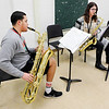"Don Knight | The Herald Bulletin<br /> From left, Tobias Swink and Hailey Short practice ""Boogie Woogie Bugle Boy"" in the band room."